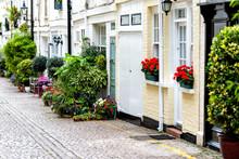 London, UK Neighborhood District Knightsbridge Kensington Or Chelsea Private Mews Alley Road Street With Plants Decorations