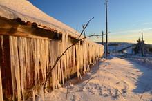 Huge Ice Stalactites On The Roof