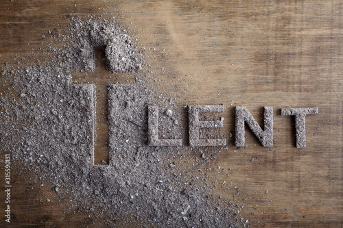 Lent word written in ash, dust as fast and abstinence period concept Wallpaper Mural