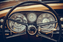Tachometer, Speedometer, Clock And Various Gauges On A Vintage Car's Dashboard