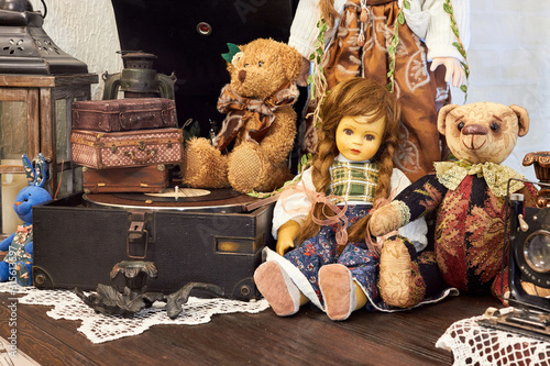 Fototapeta Vintage background with collection of antique childhood treasures - dolls and to