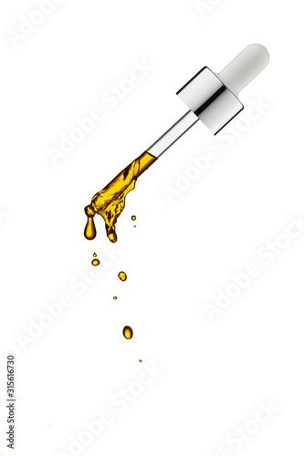 Fotografía  Cosmetic pipette with drops.