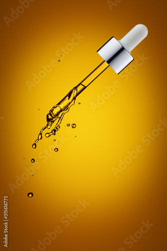 Fotomural  Cosmetic pipette with drops.