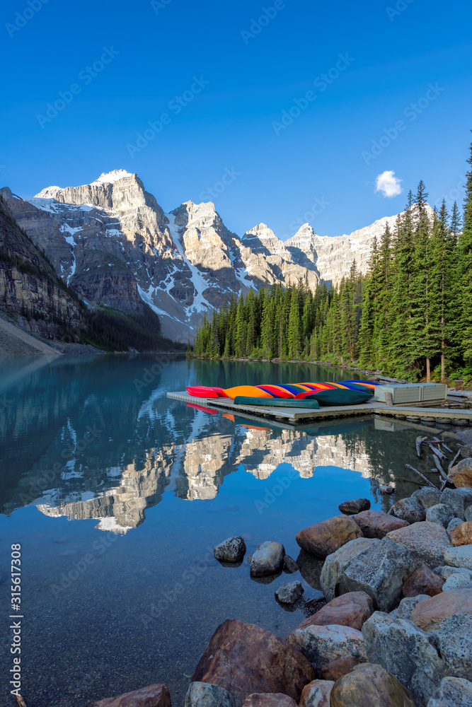 Fototapeta Beautiful Moraine Lake at sunrise in Rocky Mountains, Banff National Park, Canada.