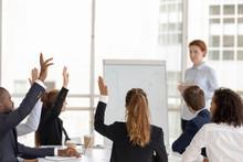 Employees Raise Hands Answerin...