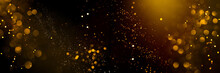 Golden Abstract Bokeh On Black Background. Holiday Concept