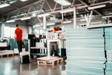 Picture Of Printing Shop Interior. Selective Focus On Pile Of Sheets.