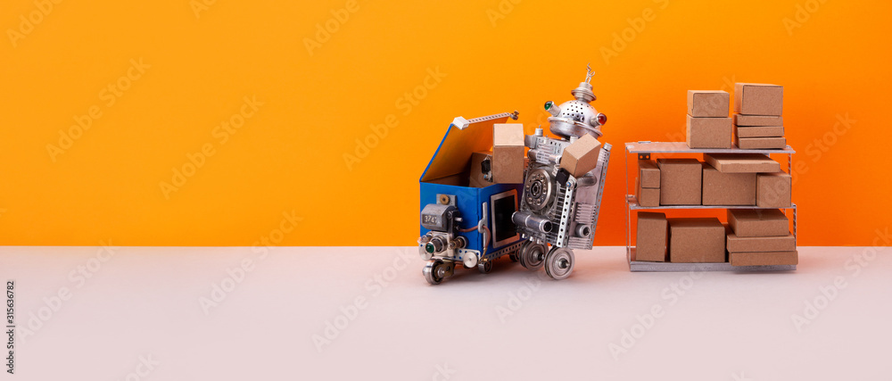 Fototapeta Automation service of warehousing and shipment. Robotic roller storekeeper sorts goods and parcels into an autonomous delivery robot courier. Orange background, copy space