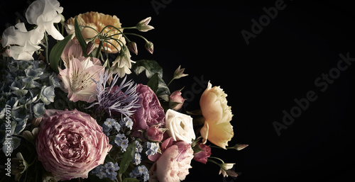 Beautiful bunch of colorful flowers on black background