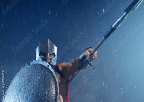 Leinwand Poster Spartan warrior fighting with spear.