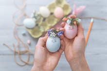 Woman Makes Cute Decorative Eggs For Easter Holiday. Do-it-yourself Easter Gifts Concept. Cute Pastel Colored Eggs