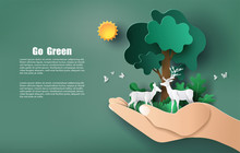 Paper Art Style Of Hand Holding Tree And Plants With Deers, Save The Planet And Energy Concept.