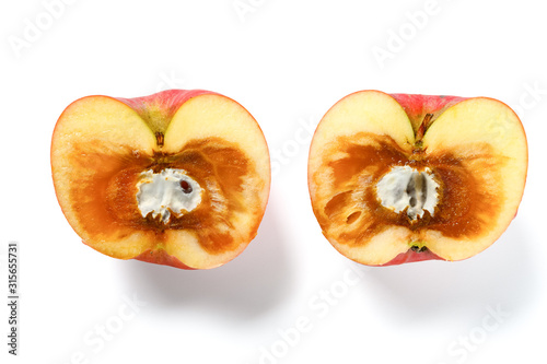 cut out badly overripe apple with moldy core on white background Tablou Canvas