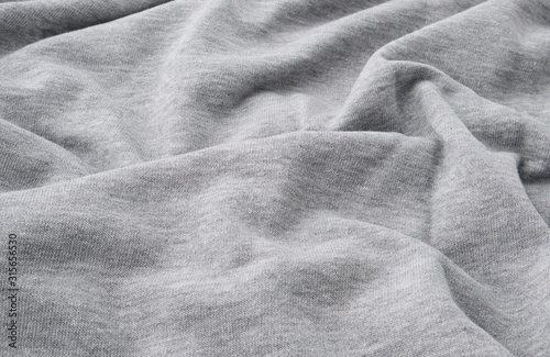 Fotografija gray cotton stretch fabric for sewing clothes, canvas with waves