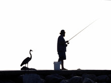 Silhouette Of A Fisherman And ...