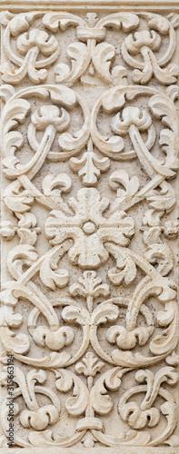 ACIREALE, ITALY - APRIL 11, 2018: The floral relief on the facade of church  Basilica Collegiata di San Sebastiano Canvas Print