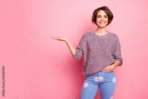 Portrait of her she nice attractive lovely pretty charming cheerful cheery brown-haired girl holding on palm advice solution decision advert isolated over pink pastel color background