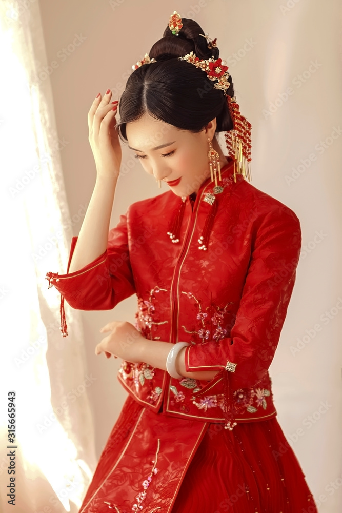 Fototapeta Asian girl in red chinese traditional costume
