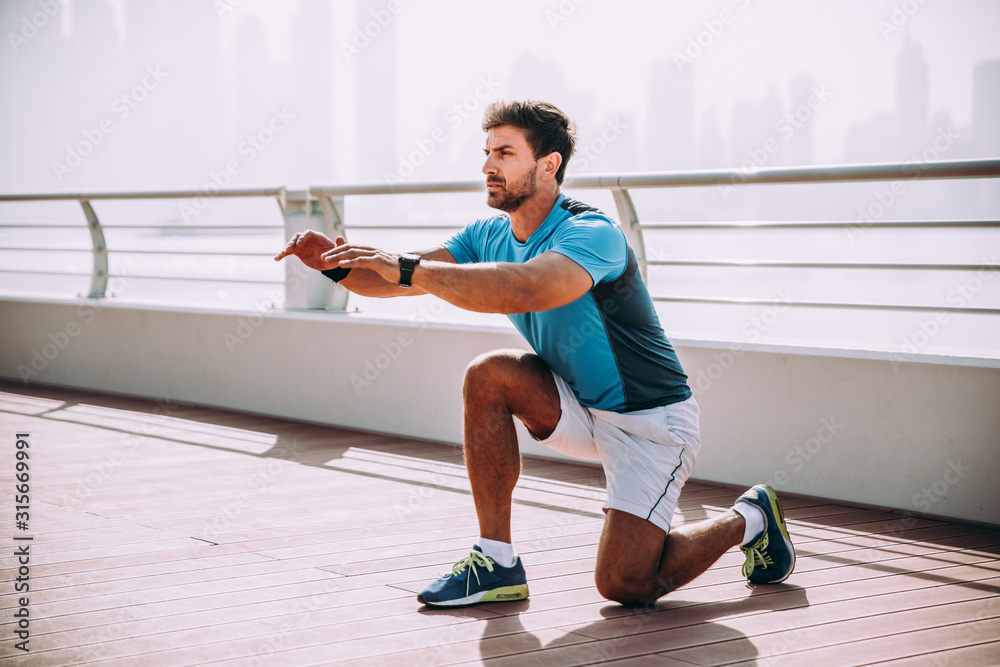 Obraz Beautiful man doing work out and different exercises outdoor fototapeta, plakat