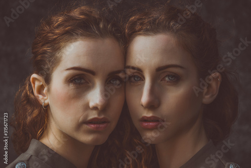 Photo Two twins sisters spending time together