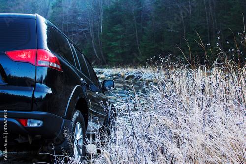 Fotografie, Obraz Off-road car driving mountain river