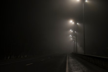 Empty Road Fog At Night. Along...