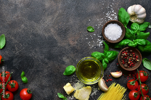 Fototapeta Culinary background with traditional ingredients of italian cuisine. Top view with copy space. obraz
