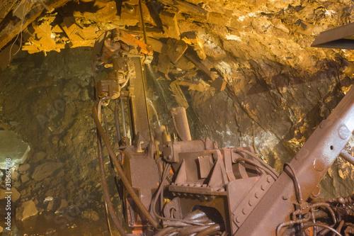 Underground gold bauxite mine shaft tunnel with drilling machine Canvas Print