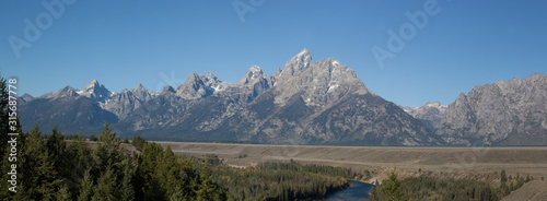 Panorama of Mountains with a blue sky #315687778