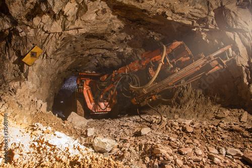Underground gold bauxite mine shaft tunnel with drilling machine Wallpaper Mural