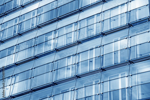 Windows of a modern building as a background.