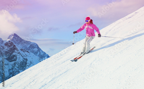Fototapeta woman skiing  in the mountains obraz
