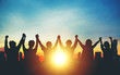 canvas print picture - Silhouette of group business team making high hands over head in sunset sky in city for business success and teamwork
