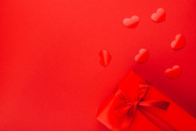Gift Box With Red Bow On Red B...
