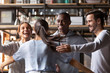 canvas print picture - Happy diverse friends giving hug meeting girlfriend in cafe