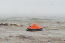 Life Raft In The Stormy Sea