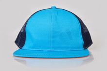Blue Baseball Cap Or Trucker Hat With Black Mesh On White Background