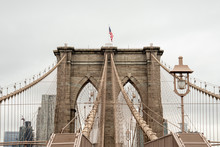 USA, New York, New York City, Cables Of Brooklyn Bridge With American Flag Standing On Top