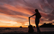 Silhouette Of Woman With Guita...