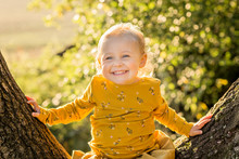 Portrait Of Happy Blond Toddle...