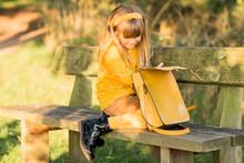 Little Blond Girl Dressed In Y...