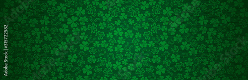 Green Patricks Day greeting banner with green clovers Fototapete