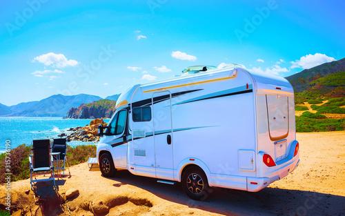 Camper on road at Capo Pecora at Mediterranean sea in Sardinia Island, Italy summer Fototapet