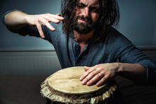 Long-haired Man Playing An Eth...