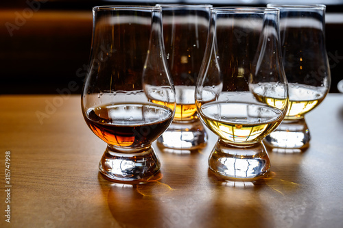 Scotch whisky, tasting glasses with variety of single malts or blended whiskey s Canvas Print