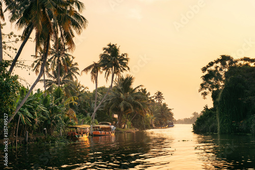 Alleppey backwaters with local boat on sunrise Canvas Print