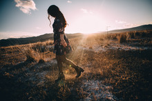 Freedom Girl Walking At Sunset