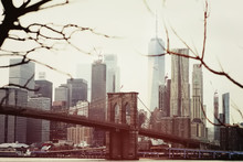 Toned Photo Of Skyscrapers Of Manhattan And Brooklyn Bridge At Winter Day. Postcard View Of New York.