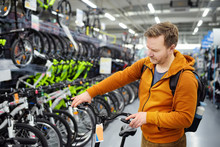 Middle Age Man Choosing Bicycl...