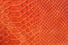 Texture Of Genuine Rough Leather Close-up, Imitation Of The Skin Of Scaly Exotic Reptile, Fashion Bright Orange Red Color
